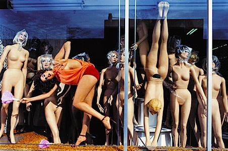 model behind glass window with shop mannequins